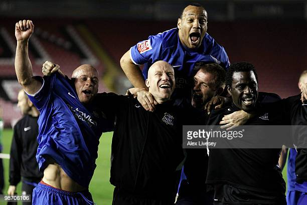 Luke Rodgers Lee Hughes and Ade Akinbiyi of Notts County celebrate after winning the Coca Cola League Two title after the Coca Cola League Two match...