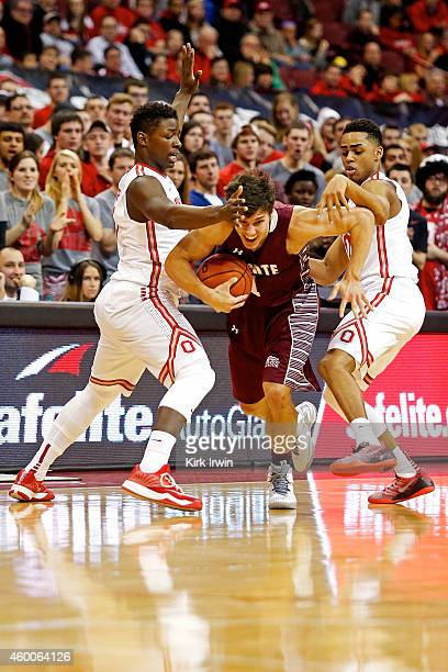 Luke Roh of the Colgate Raiders attempts to get through the defense of JaeÕSean Tate of the Ohio State Buckeyes and DÕAngelo Russell of the Ohio...