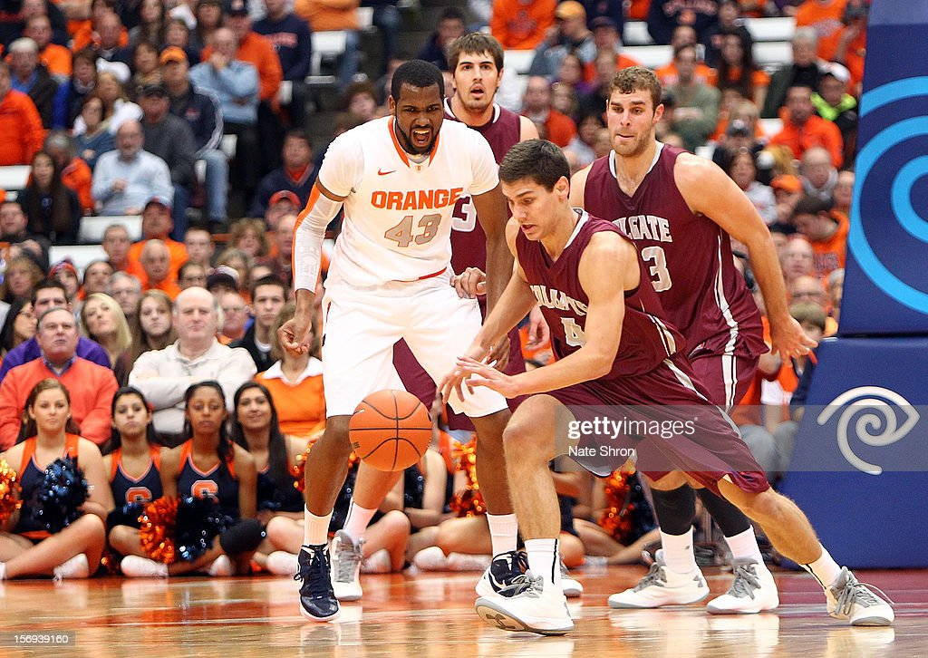 Luke Roh #4 of the Colgate Raiders reaches for the ball as teamtates John Brandenburg #3 and Murphy Burnatowski #13 look on as he is chased by James Southerland #43 of the Syracuse Orange during the game at the Carrier Dome on November 25, 2012 in Syracuse, New York.