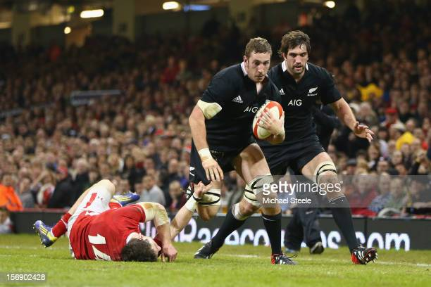 Luke Romano of New Zealand beats the challenge of Alex Cuthbert of Wales to score a try during the International match between Wales and New Zealand...