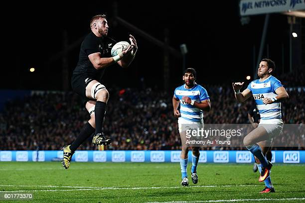 Luke Romano of New Zealand catches the high ball off teammate Israel Dagg to score a try during the Rugby Championship match between the New Zealand...