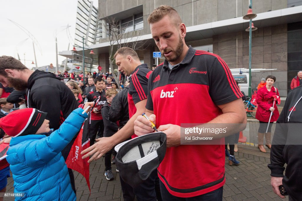 Luke Romano of the Crusaders greets fans during a parade at Christchurch Art Gallery on August 8, 2017 in Christchurch, New Zealand. The Crusaders beat the Lions to win the 2017 Super Rugby Final on Saturday night in Johannesburg.