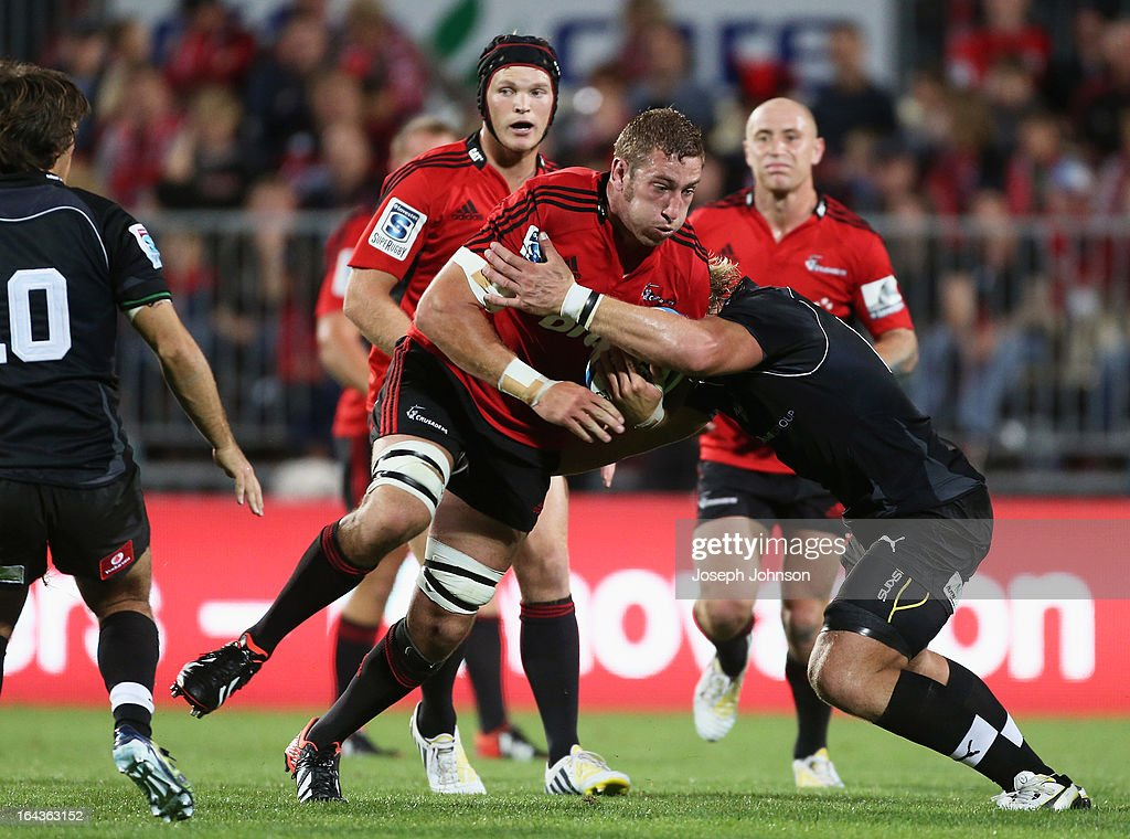 Luke Romano of the Crusaders in the tackle of Jacques Engelbrecht during the round six Super Rugby match between the Crusaders and the Kings at AMI Stadium on March 23, 2013 in Christchurch, New Zealand.