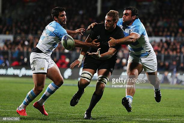 Luke Romano of the New Zealand All Blacks offloads the ball during The Rugby Championship match between the New Zealand All Blacks and Argentina at...