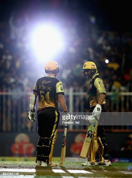 Luke Ronch of Punjabi Legends speaks to Shoaib Malik of Punjabi Legends during the semi final T10 League match between Pakhtoons and Punjabi Legends...