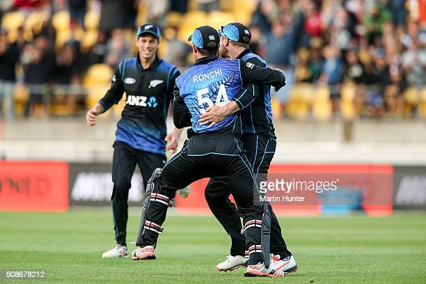 Luke Ronchi and Brendon McCullum of New Zealand celebrate the dismissal of Steve Smith of Australia during game two of the one day international...