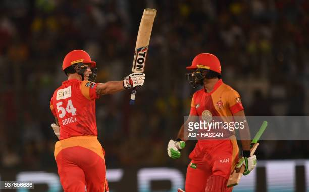Luke Ronchi of Islamabad United waves his bat after his fifty runs with his partner Sahibzada Farhan during the Pakistan Super League final match...