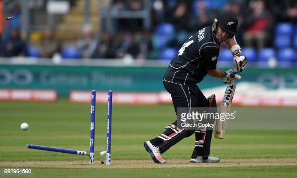 Luke Ronchi of New Zealand is bowled by Jake Ball of England during the ICC Champions Trophy match between England v New Zealand at SWALEC Stadium on...