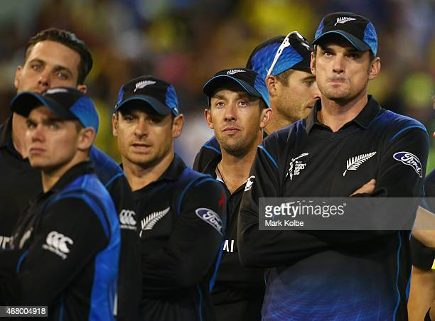 Luke Ronchi of New Zealand looks dejected as he stands with his team mates after defeat during the 2015 ICC Cricket World Cup final match between...