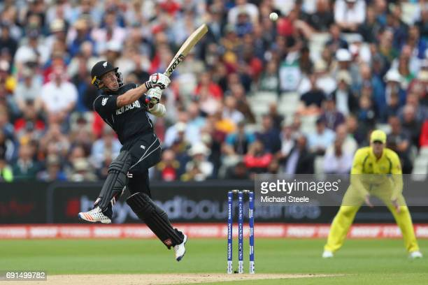 Luke Ronchi of New Zealand pulls a delivery from Pat Cummins to the fine leg boundary during the ICC Champions Trophy match between Australia and New...