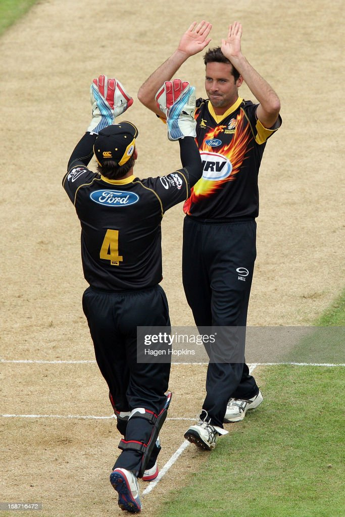 Luke Ronchi (L) of Wellington congratulates teammate Dane Hutchinson on taking the wicket of Jamie How of Central Districts during the Twenty20 match between Wellington Firebirds and Central Stags at Hawkins Basin Reserve on December 26, 2012 in Wellington, New Zealand.