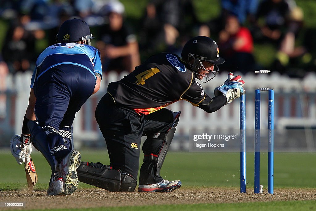 Luke Ronchi of Wellington runs out Reece Young of Auckland during the HRV Cup Twenty20 Preliminary Final between the Wellington Firebirds and the Auckland Aces at Basin Reserve on January 18, 2013 in Wellington, New Zealand.