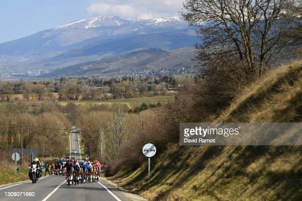 Luke Rowe of United Kingdom, Rohan Dennis of Australia and Team INEOS Grenadiers Blue Points Jersey & The Peloton during the 100th Volta Ciclista a...