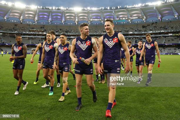 Luke Ryan and Brennan Cox of the Dockers share a moment while walking from the field after winning the round 17 AFL match between the Fremantle...