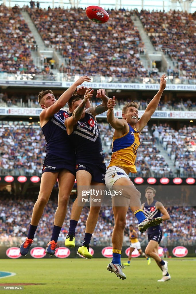 Luke Ryan and Nathan Wilson of the Dockers contest a mark against Mark LeCras of the Eagles during the Round 6 AFL match between the Fremantle Dockers and West Coast Eagles at Optus Stadium on April 29, 2018 in Perth, Australia.