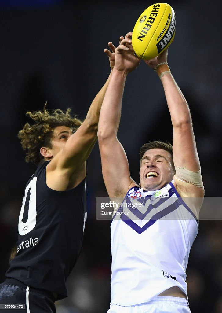 Luke Ryan of the Dockers marks infront of Charlie Curnow of the Blues during the round 13 AFL match between the Carlton Blues and the Fremantle Dockers at Etihad Stadium on June 16, 2018 in Melbourne, Australia.