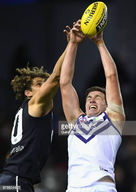 Luke Ryan of the Dockers marks infront of Charlie Curnow of the Blues during the round 13 AFL match between the Carlton Blues and the Fremantle...