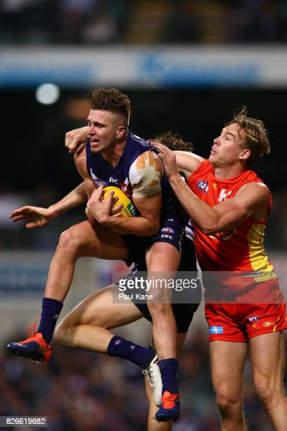 Luke Ryan of the Dockers takes a contested mark during the round 20 AFL match between the Fremantle Dockers and the Gold Coast Suns at Domain Stadium...
