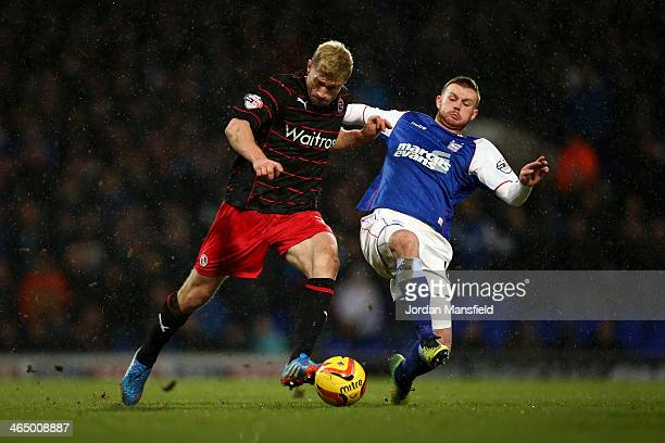 Luke Ryan Tunnicliffe of Ipswich Town battles for possension with Pavel Pogrebnyak of Reading during the Sky Bet Championship match between Ipswich...