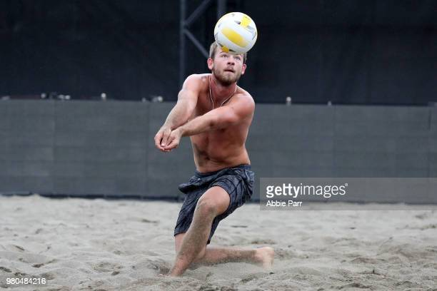 Eric Brelia reaches for the ball against Elias Aparcedo during qualifications of the AVP Seattle Open at Lake Sammamish State Park on June 21 2018 in...