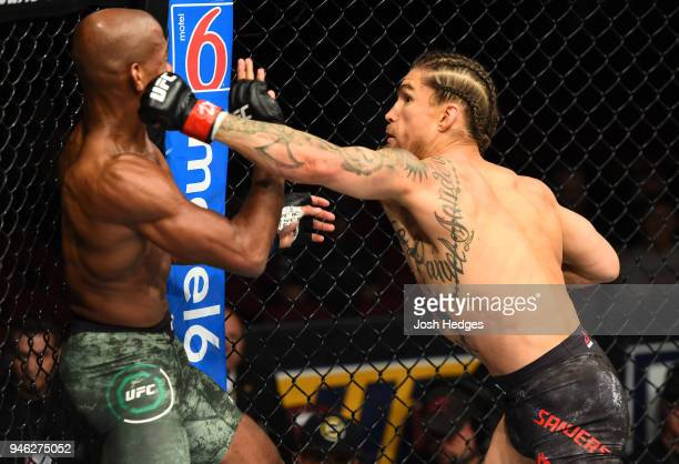 Luke Sanders punches Patrick Williams in their bantamweight fight during the UFC Fight Night event at the Gila Rivera Arena on April 14 2018 in...