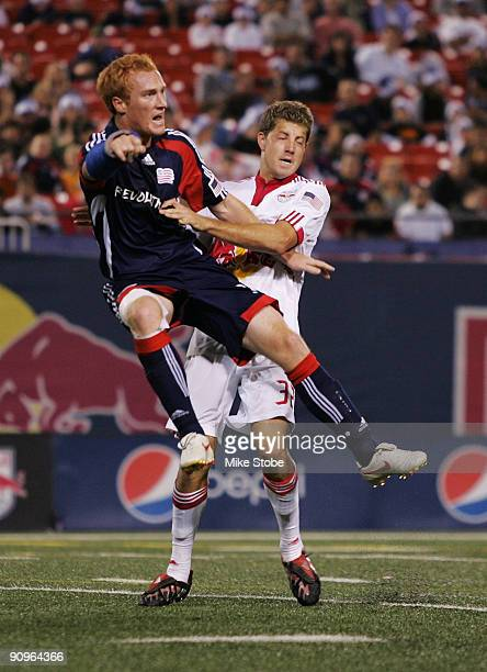 Luke Sassano of the New York Red Bulls and Jeff Larentowicz of the New England Revolution get tangled up at midfield at Giants Stadium in the...