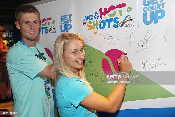 Luke Saville and Daria Gavrilova of Australia sign their autographs at Autograph Island during the 2015 Australian Open at Melbourne Park on January...
