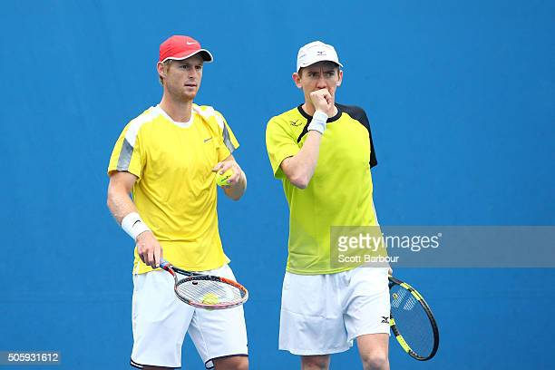 Luke Saville and JohnPatrick Smith of Australia talk tactics in their first round match against Henri Kontinen of Finland and John Peers of Australia...
