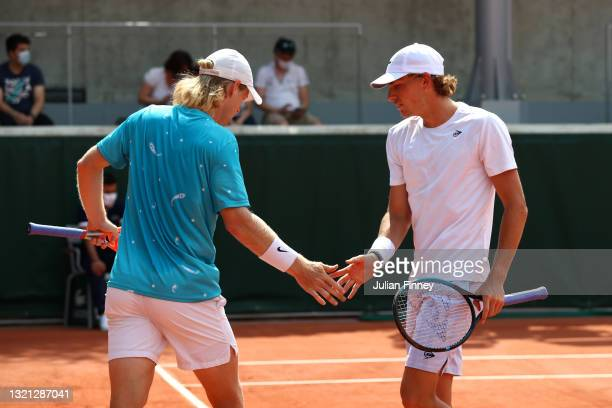Luke Saville and Max Purcell of Australia during their mens first round match against Albano Olivetti and Gregoire Barrere of France during day four...