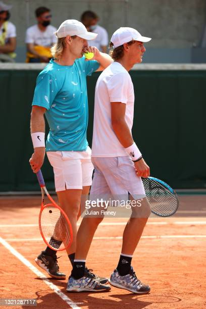 Luke Saville and Max Purcell of Australia react during their mens first round match against Albano Olivetti and Gregoire Barrere of France during day...