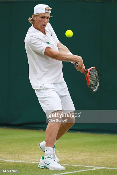 Luke Saville of Asutralia in action during his Boys' Singles first round match against Laurent Lokoli of France on day seven of the Wimbledon Lawn...