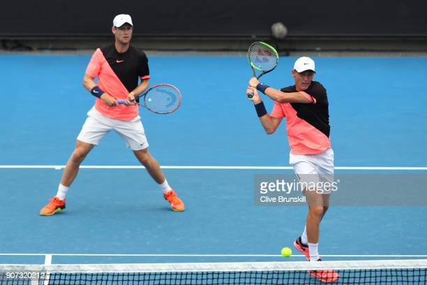 Luke Saville of Australia and Max Purcell of Australia compete in their second round men's doubles match against Lukasz Kubot of Poland and Marcelo...