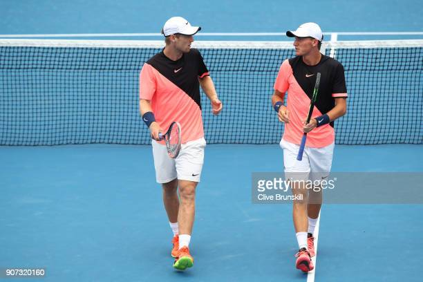 Luke Saville of Australia and Max Purcell of Australia talk tactics in their second round men's doubles match against Lukasz Kubot of Poland and...