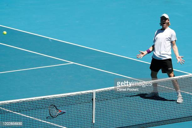 Luke Saville of Australia celebrates after winning match point in his Men's Doubles Semifinals match with partner Max Purcell against Ivan Dodig of...