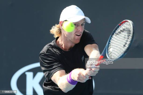 Luke Saville of Australia plays a backhand in his match against Jozef Kovalik of Slovakia during 2020 Australian Open Qualifying at Melbourne Park on...