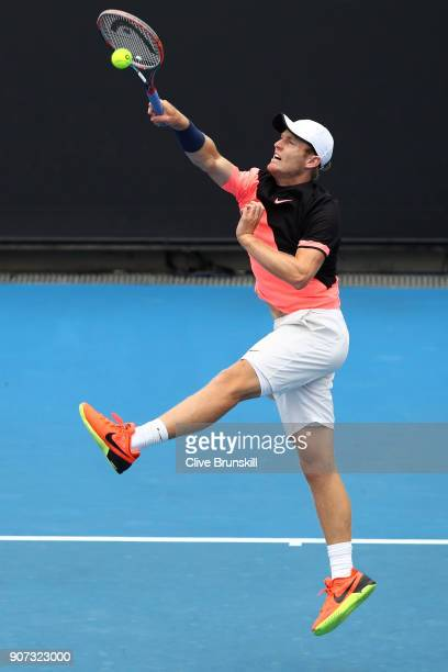 Luke Saville of Australia plays a forehand smash in his second round men's doubles match with Max Purcell of Australia against Lukasz Kubot of Poland...