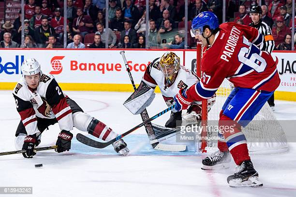 Luke Schenn of the Arizona Coyotes blocks a pass by Max Pacioretty of the Montreal Canadiens near goaltender Justin Peters during the NHL game at the...