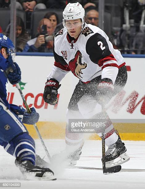 Luke Schenn of the Arizona Coyotes defends against the Toronto Maple Leafs during an NHL game at the Air Canada Centre on December 15 2016 in Toronto...