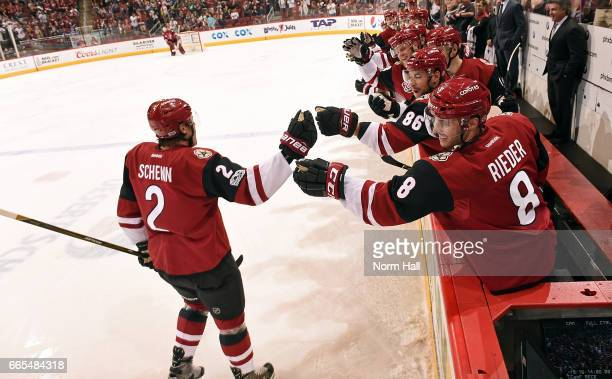 Luke Schenn of the Arizona Coyotes is congratulated by Tobias Rieder and teammates after scoring a first period goal against the Vancouver Canucks at...