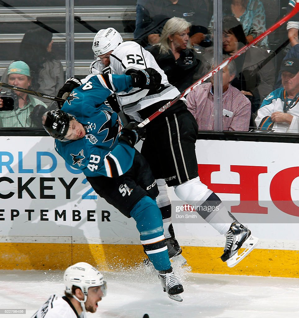 Luke Schenn #52 of the Los Angeles Kings finishes his check on Tomas Hertl #48 of the San Jose Sharks during the Western Conference First Round during the 2016 NHL Stanley Cup Playoffs at the SAP Center at San Jose on April 20, 2016 in San Jose, California.
