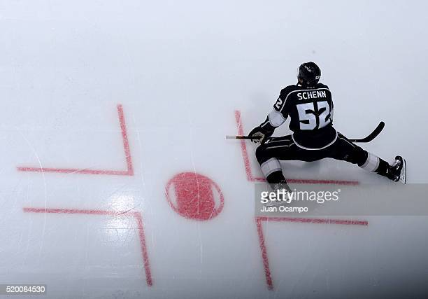 Luke Schenn of the Los Angeles Kings stretches during warm ups before the game against the Winnipeg Jets on April 9 2016 at STAPLES Center in Los...