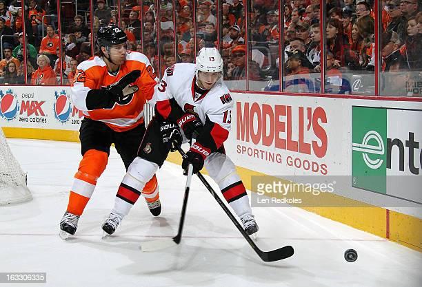 Luke Schenn of the Philadelphia Flyers battles for the puck against Peter Regin of the Ottawa Senators on March 2, 2013 at the Wells Fargo Center in...