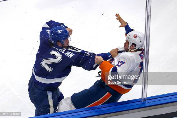 Luke Schenn of the Tampa Bay Lightning and Matt Martin of the New York Islanders fight during the second period at Rogers Place on September 09, 2020...