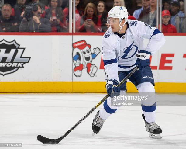 Luke Schenn of the Tampa Bay Lightning controls the puck against the Detroit Red Wings during an NHL game at Little Caesars Arena on March 8, 2020 in...