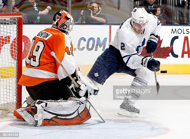 Luke Schenn of the Toronto Maple Leafs is stopped in close by Michael Leighton of the Philadelphia Flyers during game action January 14 2010 at the...