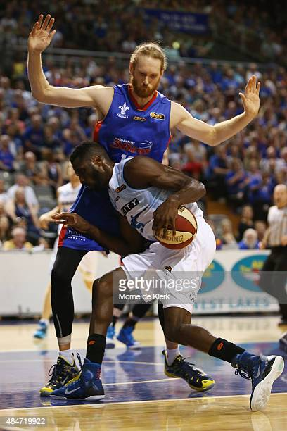 Luke Schenscher of the 36ers block Ekene Ibekwe of the Breakers during game two of the NBL Finals series between the New Zealand Breakers and the...