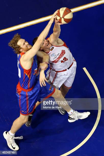 Luke Schenscher of the 36ers competes with Dave Gruber of the Hawks during the round eight NBL match between the Adelaide 36ers and the Wollongong...