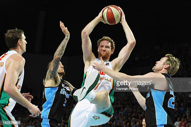 Luke Schenscher of the Crocodiles secures posession during game three of the NBL Finals series between the Townsville Crocodiles and the New Zealand...