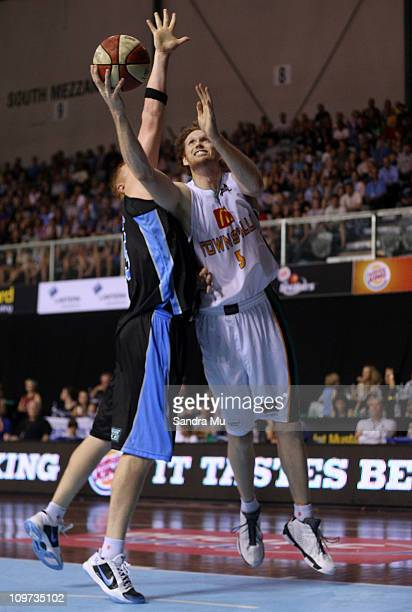 Luke Schenscher of the Crocs lays the ball up during the round 21 NBL match between the New Zealand Breakers and the Townsville Crocodiles at North...