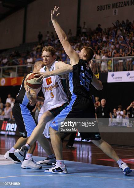 Luke Schenscher of the Crocs pushes past Gary Wilkinson of the Breakers during the round 21 NBL match between the New Zealand Breakers and the...